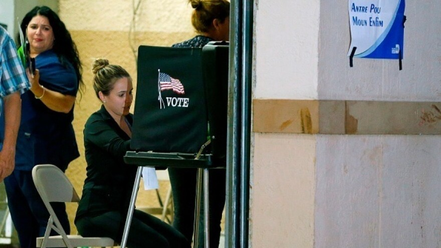 South Florida voters cast their vote late in the day at a busy polling center in Miami on Nov. 6, 2018.