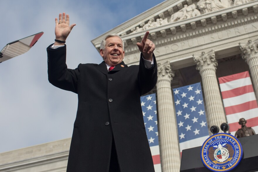 Gov. Mike Parson points and waves to attendees at the Missouri Bicentennial Inauguration ceremony on Monday on the South Lawn of the Missouri State Capitol Building in Jefferson City. Parson serves as the state's 57th governor.