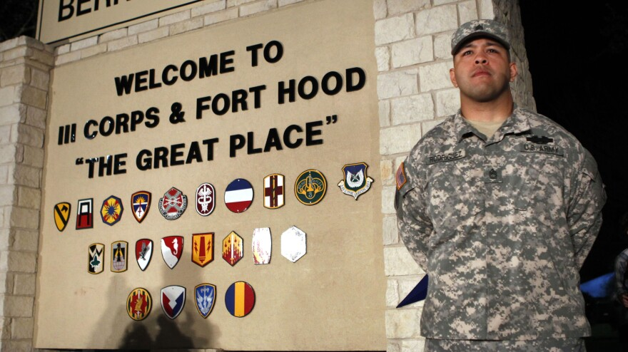 Sgt. First Class Erick Rodriguez stood guard at the entrance to Fort Hood as officials prepared to brief the news media about Wednesday's attack at the post.