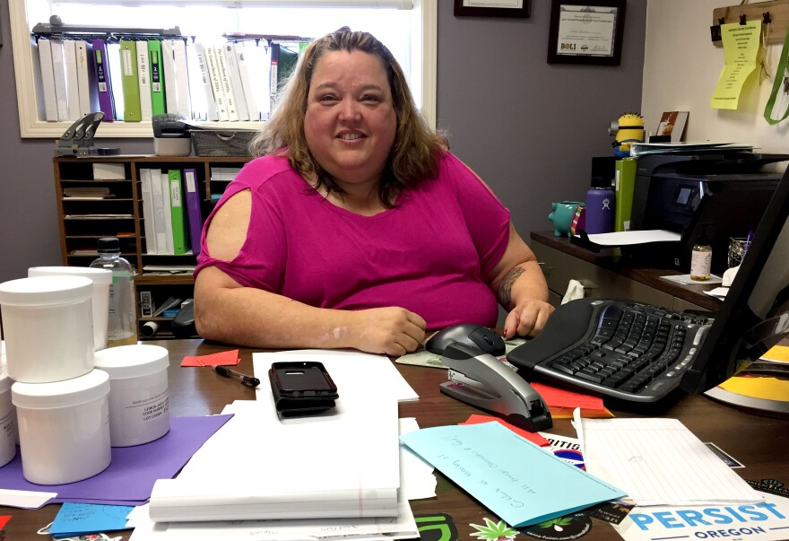 Image of woman sitting at desk.