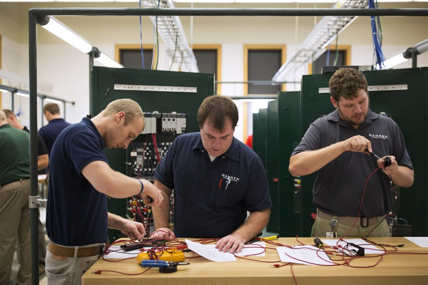 Scott Ranft, Stephen Mausshardt and Brandon Weinrich work at Ranken Technical College's Programmable Logic Controllers Lab.