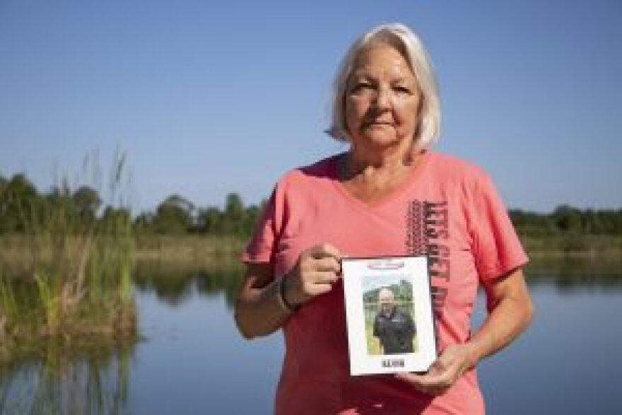 Audrey Jowett holds a picture of her husband, Kevin.
