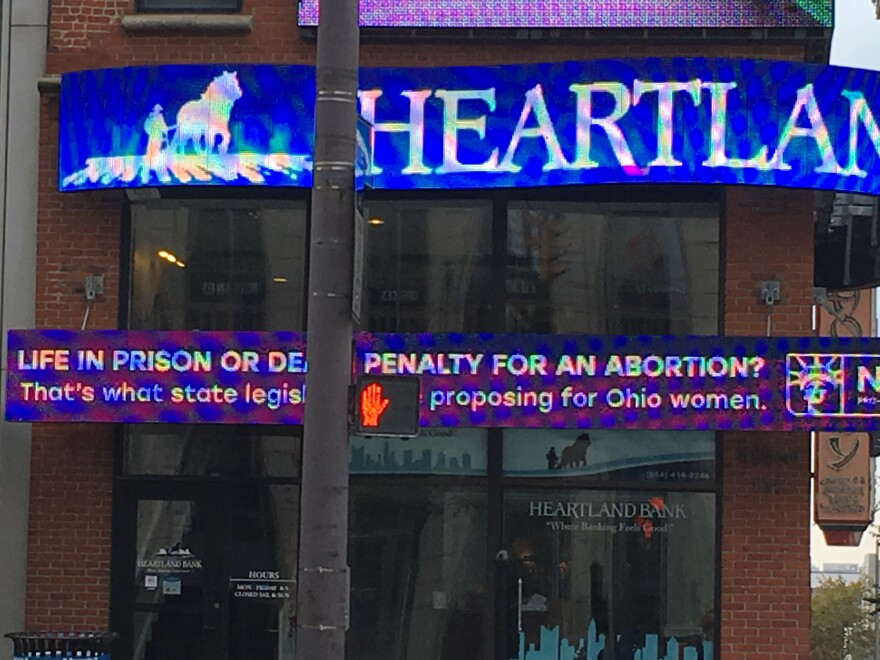 A picture of an ad about the bill in question on a bank building near Ohio Statehouse.