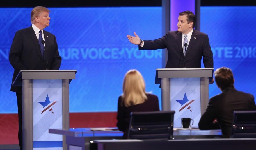 Republican presidential candidates Donald Trump and Sen. Ted Cruz participate in the Republican presidential debate in Manchester, New Hampshire.