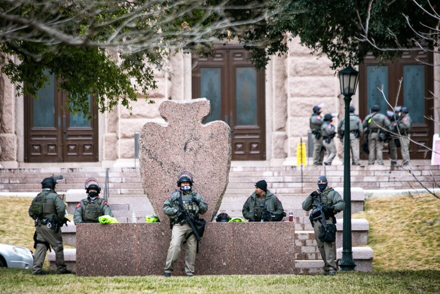 Texas Department of Public Safety DPS officers stand watch on the grounds of the state Capitol on Inauguration Day.
