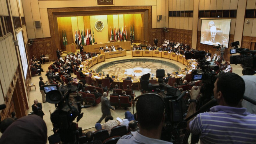 <p>Cameramen film the Arab Foreign Ministers meeting at the Arab League headquarters in Cairo.</p>
