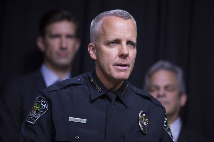 Austin Police Chief Brian Manley, with City Manager Spencer Cronk and Austin Mayor Steve Adler behind him.