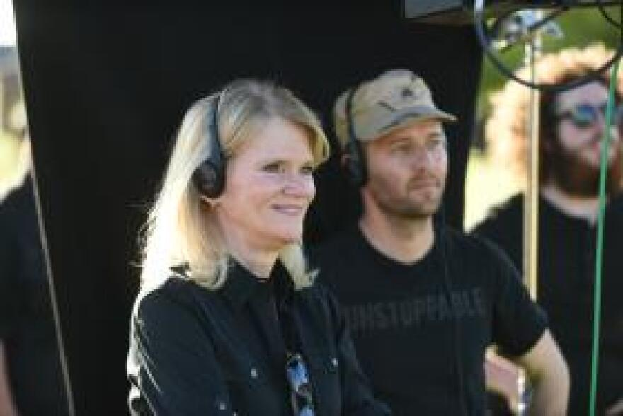 """Author Martha Raddatz and series creator Mikko Alanne on set of """"The Long Road Home"""" at Fort Hood."""