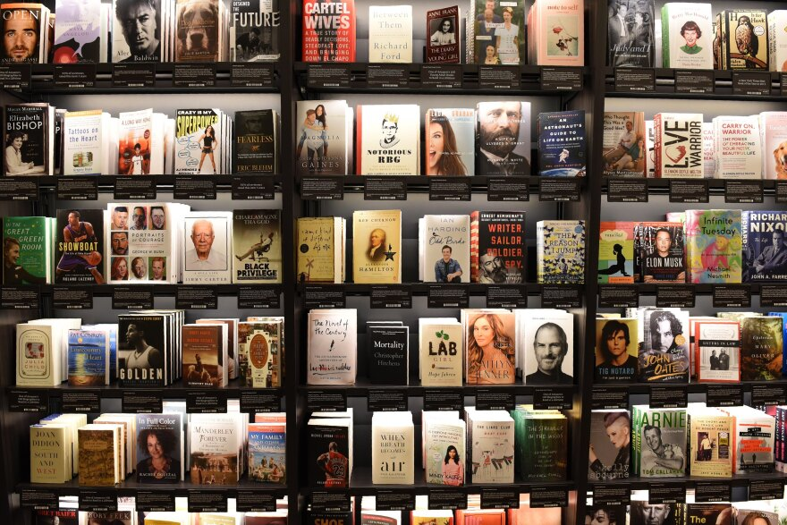 "Books at Amazon's New York City store are shelved with the covers facing out and organized around features that originated on the website, including ""Most Wished For"" and ""Customers Who Bought This Item Also Bought."""