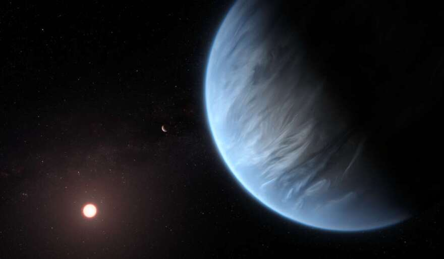 This artist's impression shows the planet K2-18b, it's host star and an accompanying planet in this system. ESA/Hubble, M. Kornmesser