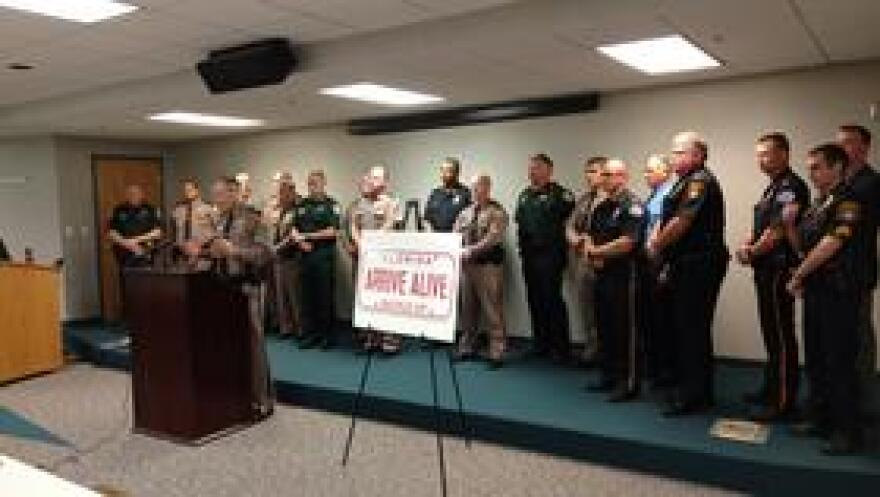 """FHP Major Warren Fast speaks before a cross-section of local and state law enforcement about the new """"Arrive Alive"""" program."""