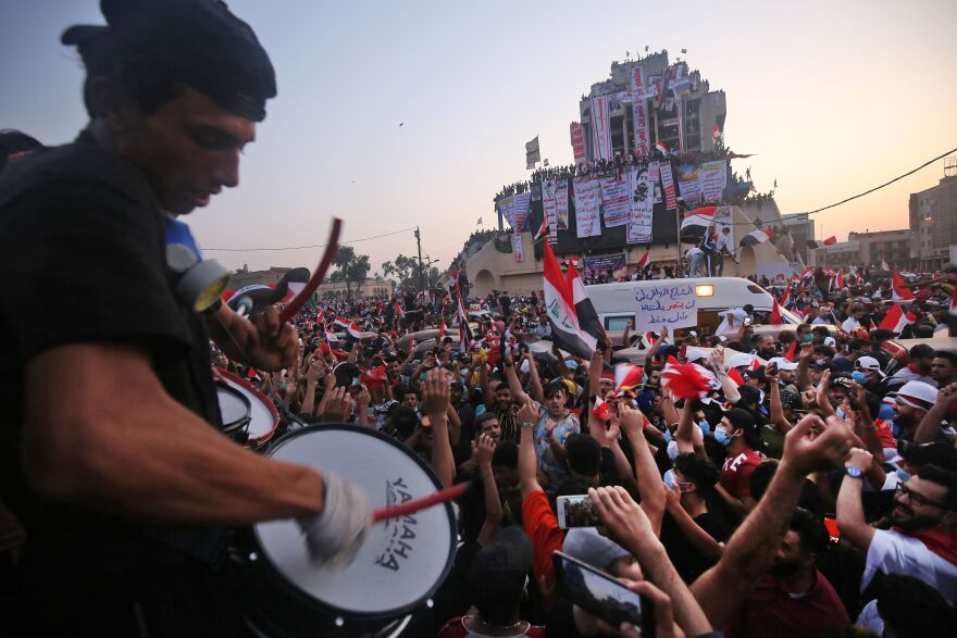 Iraqi protesters gather for anti-government demonstrations Wednesday in Baghdad. Rallies in the capital and across the south have swelled in recent days, defying curfews, threats of arrest and violence from security forces.