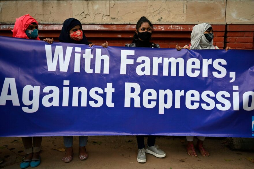 Demonstrators take part in a march organised in support of farmers protesting against the central governments recent agricultural reforms in New Delhi.