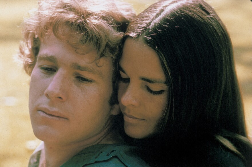 Ryan O'Neal and Ali MacGraw starred in <em>Love Story</em> — a romantic tearjerker that became the highest grossing movie of 1970. Since then, it has inspired countless ugly cries — and plenty of parodies, too.