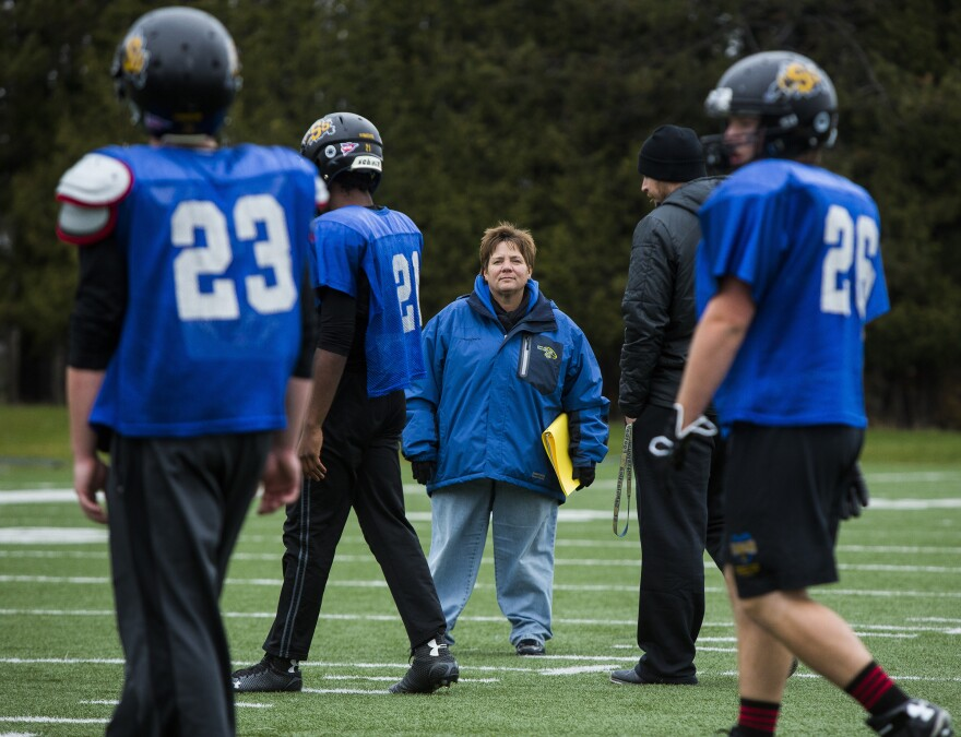 Sister Lisa Maurer, nun and kicking coach for the College of St. Scholastica football team, watches during drills in October.