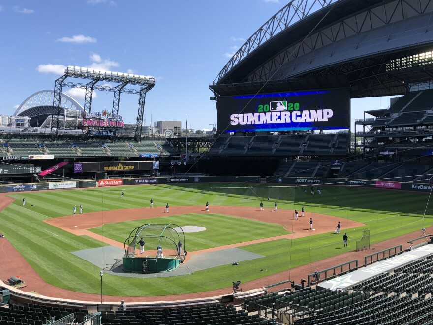 Seattle Mariners players are gearing up for the start of a shortened regular season. At their home ballpark, summer training is underway this week with strict coronavirus restrictions.