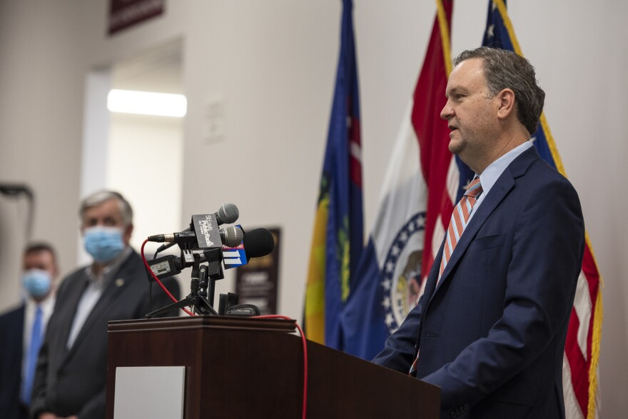 St. Louis County Executive Sam Page and county municipalities are trying to hash out a deal to send federal money to municipal police and fire departments.