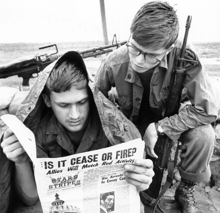 U.S. troops read <em>Stars and Stripes</em> newspaper in Cu Chi, South Vietnam in 1969. The Pentagon plans to shut down the paper, aimed at U.S. military personnel, at the end of this month.