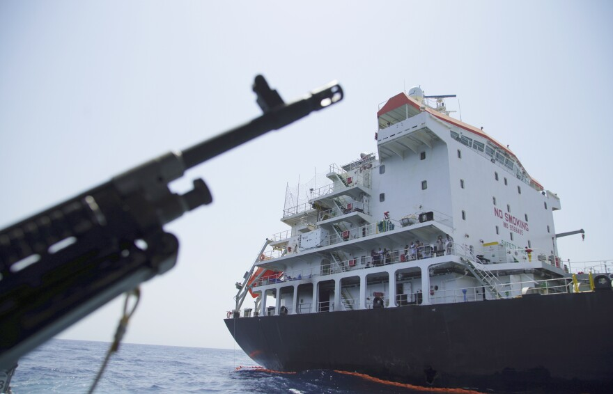 The U.S. Navy says a limpet mine put a hole in this Panama-flagged, Japanese-owned tanker anchored off Fujairah, United Arab Emirates. The limpet mines used to attack the tanker near the Strait of Hormuz resemble mines displayed by Iran, a Navy explosives expert said Wednesday. Iran denies being involved.