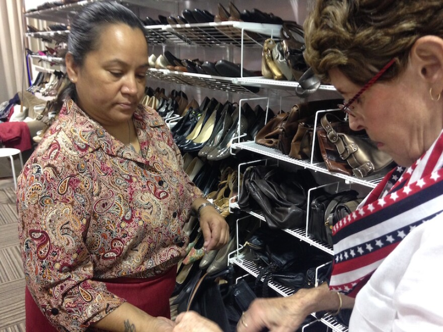 Terri Bollman, a former field medic, gets coaching from Michele Mason at Dress for Success.