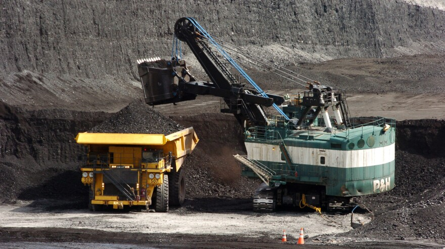 Stanford University's trustees says the school will rid itself of any investments it has made in coal-producing companies. A 2013 file photo shows coal being loaded onto a truck at a mine near Decker, Montana.