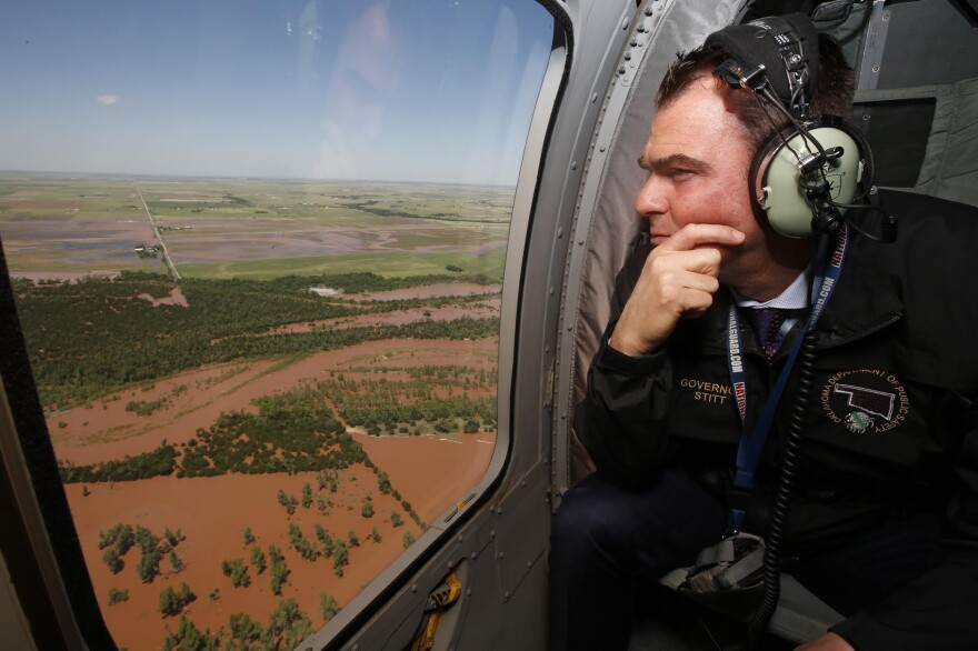 Oklahoma Gov. Kevin Stitt surveys flooding damage near Minco, Okla., from the air Tuesday, May 21, 2019, following heavy rains across the state. (Sue Ogrocki/AP)