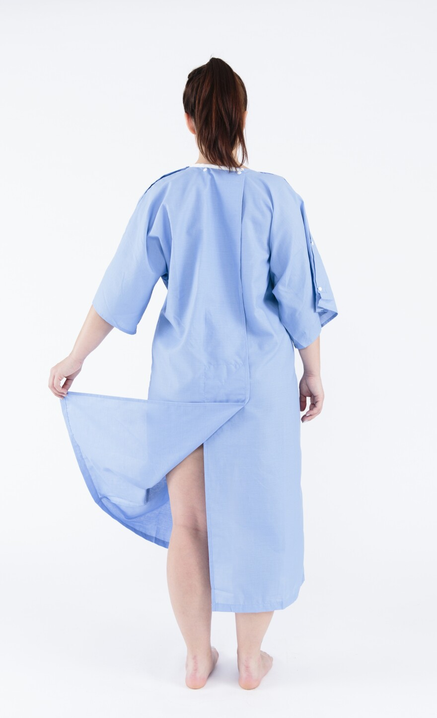 Instead of flimsy ties, the back of the new gown has a flap to cover the patient's behind.