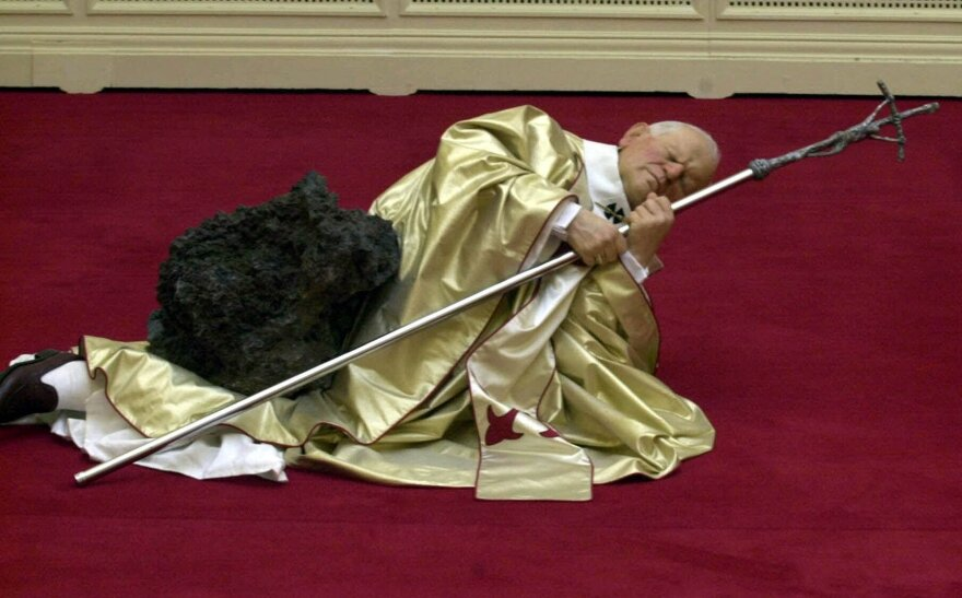 Maurizio Cattelan's waxwork depicting Pope John Paul II after being struck by a meteorite was on display in Sept. 2000 at the Royal Academy in London.