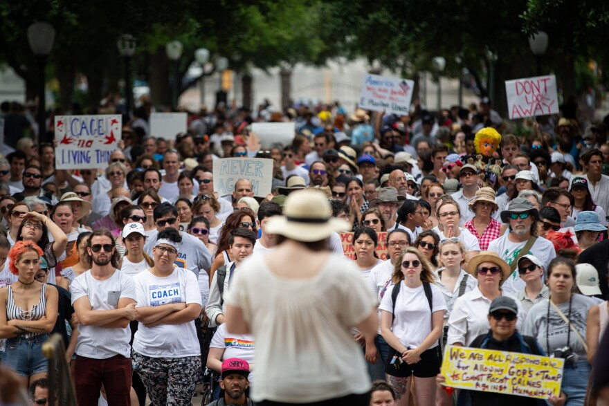A crowd at the Texas Capitol protests migrant detention camps