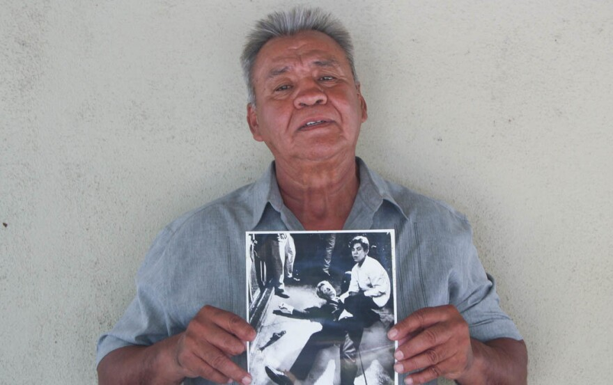 Juan Romero, 67, at his home in Modesto, Calif., holds a photo of himself and Sen. Robert F. Kennedy, taken by <em>The Los Angeles Times' </em>Boris Yaro on June 5, 1968.