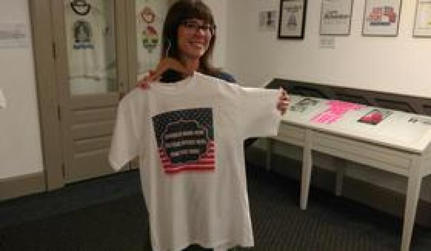 Capitol Exhibits Manager Michelle Sunset with a shirt that bears a somewhat generic message.