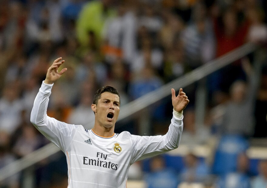 Real Madrid's Portuguese forward Cristiano Ronaldo reacts during the Spanish league football match Real Madrid CF vs Valencia CF at the Santiago Bernabeu stadium in Madrid Sunday.