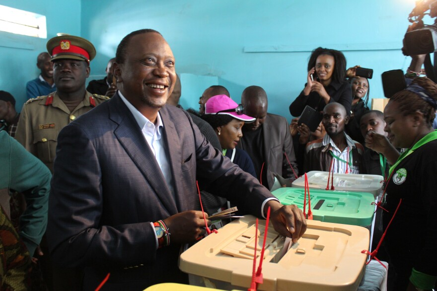 President Uhuru Kenyatta casts his vote during the general elections. Kenyatta was the declared the winner of the disputed rerun of Kenya's presidential election.