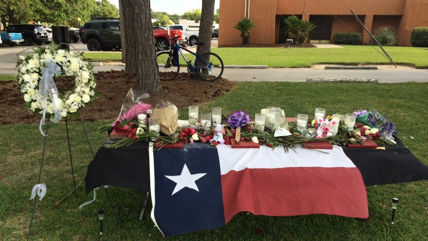 After a gunman killed eight students and two teachers at the high school in Santa Fe, Texas, on Friday, memorials to the victims were created.