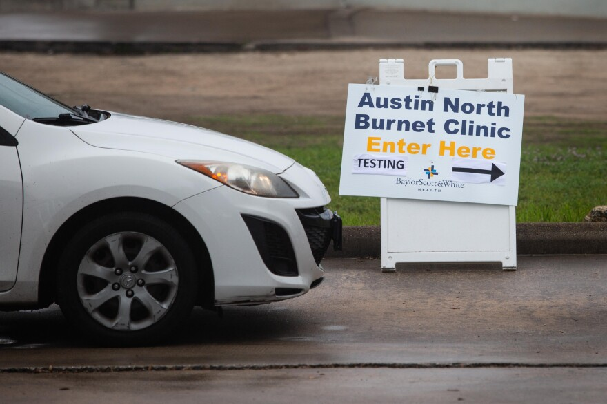 A car pulls up to a drive-thru COVID-19 testing site in North Austin.