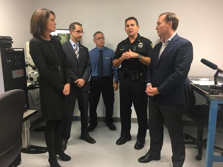 State Attorney Melissa Nelson (left) along with Sheriff Mike Williams and Mayor Lenny Curry (right) and others show off Jacksonville's new IBIS.