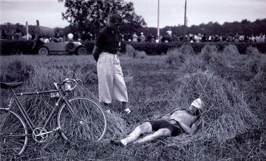 Amedee Fournier naps in a hay field after riding through the Pyrenees in 1939.