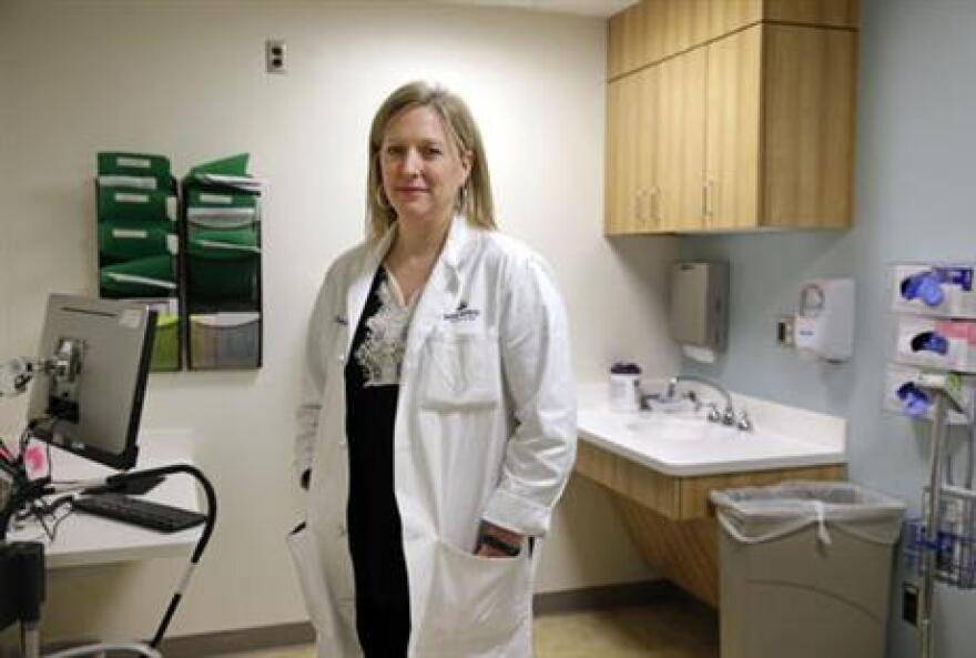 In this April 28, 2016 photo, Dr. Jeanne Sheffield, a Johns Hopkins University obstetrician who has advised the Centers for Disease Control and Prevention on Zika-related pregnancy issues, in an examination room in at Johns Hopkins Hospital in Baltimore.