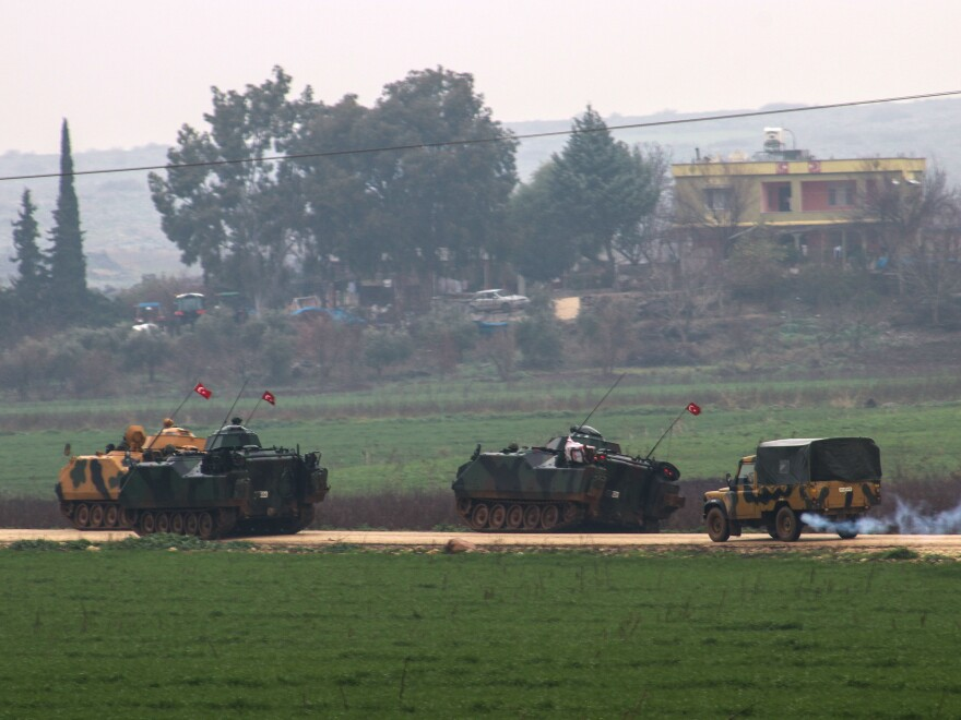 "Turkish military tanks are prepared for deployment as part of the ""Operation Olive Branch"" to the Syrian border in Hatay, Turkey, on Thursday."