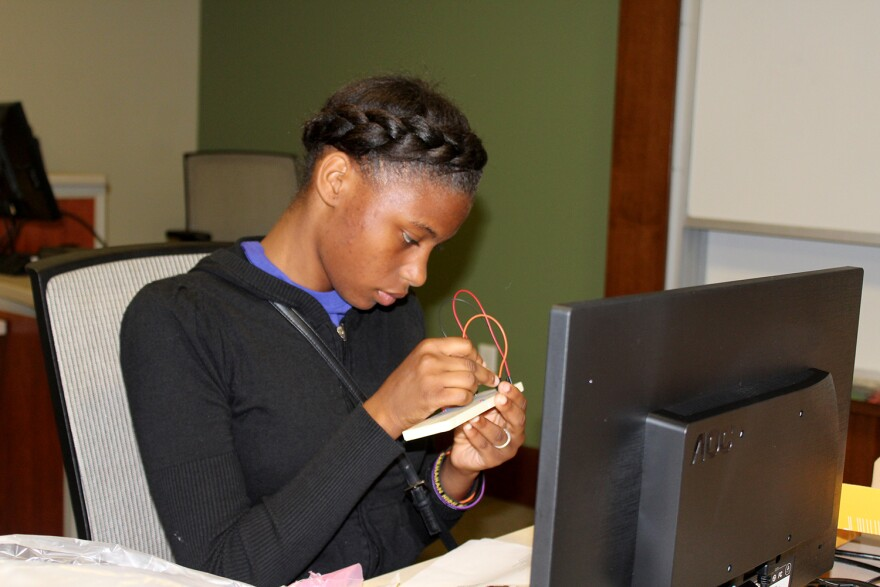Savannah Allen of Carr Lane VPA Middle School in the St. Louis public school district builds a computer at workshop for middle school girls offered by Webster University Oct. 21, 2017.