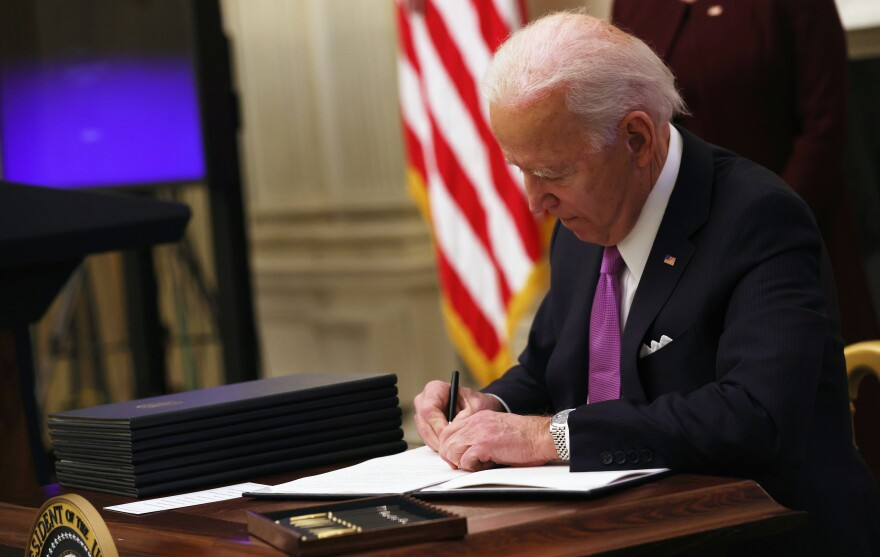 President Biden signs an executive order on Thursday.