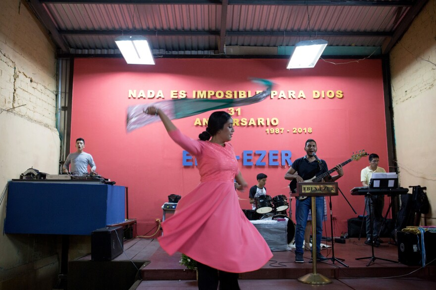 A congregation member dances during a service at Eben-ezer.