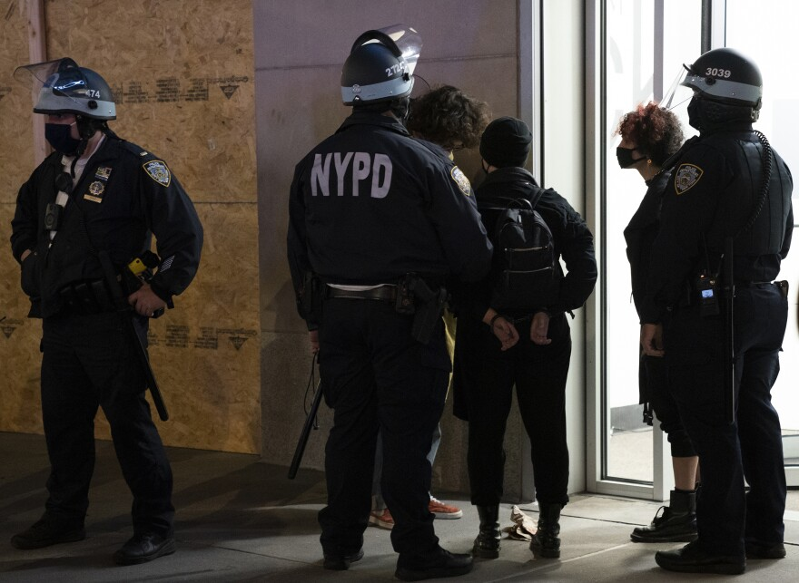 Police officers arrest some protesters in New York City on Wednesday.