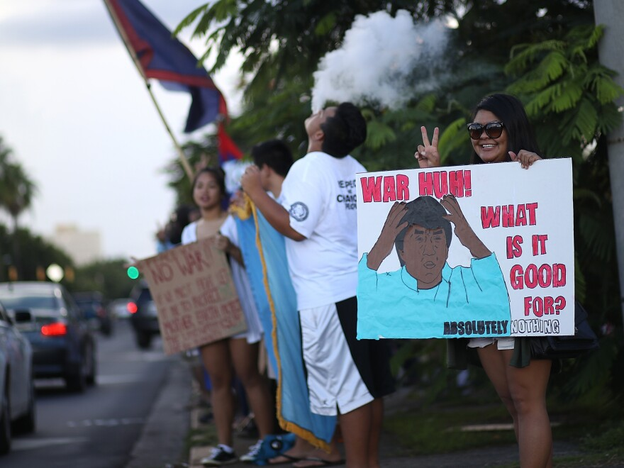 As the date for North Korea's missile launch toward Guam approached, protesters held a peace rally in Hagatna, Guam. On Tuesday, North Korea's regime opted not to launch missiles toward the U.S. territory.