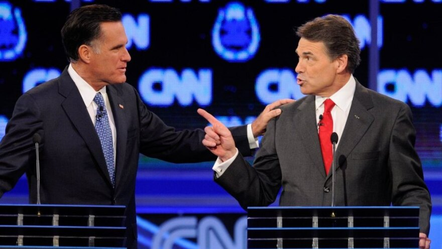 <p>Former Massachusetts Gov. Mitt Romney (left) and Texas Gov. Rick Perry got into a heated exchange about immigration during Tuesday's GOP presidential debate in Las Vegas.</p>