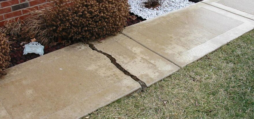 Cracks in a sidewalk are tell-tale signs of mine subsidence.