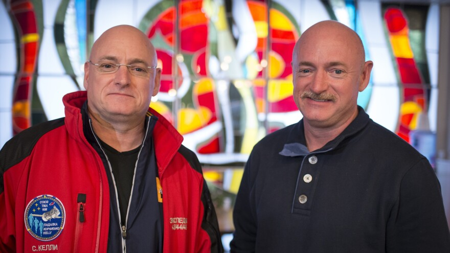 Expedition 43 NASA astronaut Scott Kelly (left) and his identical twin, Mark Kelly, pose for a photograph in 2015 at the Cosmonaut Hotel in Baikonur, Kazakhstan.