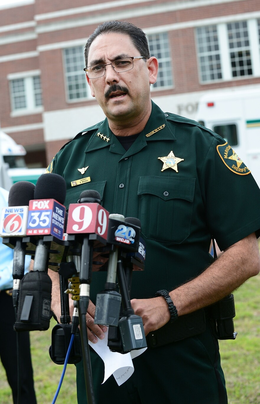 "Marion County Sheriff Billy Woods speaks during a press conference in Ocala, Fla., in 2018. Woods sent an email Tuesday informing the approximately 900 people working in the department that ""when you are on-duty/working as my employee and representing my Office – masks will not be worn,"" the Ocala<em> Star-Banner</em> reports."