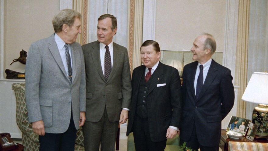Then-Vice President George H.W. Bush meets with members of a commission set up in 1986 to probe the operations of the National Security Council staff in the wake of the Iran-Contra scandal. Pictured are former Secretary of State Edmund Muskie (from left), Bush, commission chairman John Tower and Ford national security adviser Brent Scowcroft.