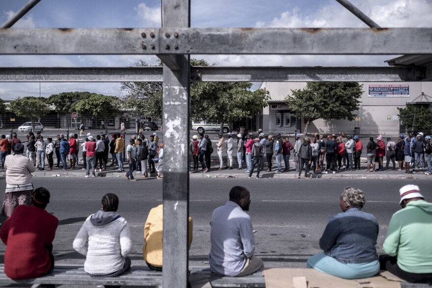 Shoppers line up outside a supermarket in the township of Khayelitsha. On day nine of the lockdown, there was a two-hour wait to get into the store.
